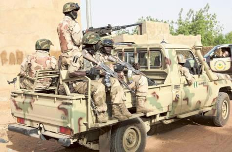 A Nigerian Army desert warfare crew and gun-truck with a Browning M2