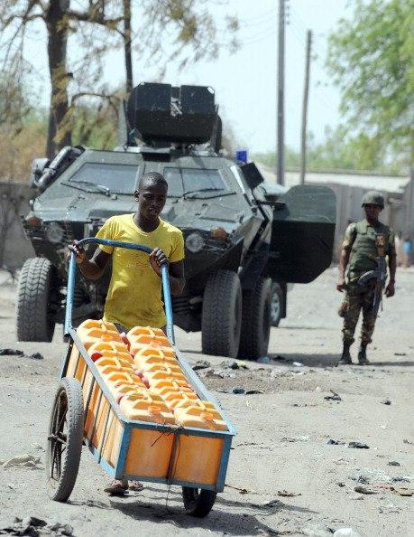 A soldier stands beside an Otokar Cobra APC at Baga in the Far Northeast corner of Nigeria