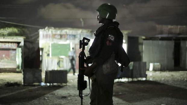 A Nigerian MOPOL cop of the AMISOM Formed Police Unit on night-time patrol in Mogadishu, Somalia