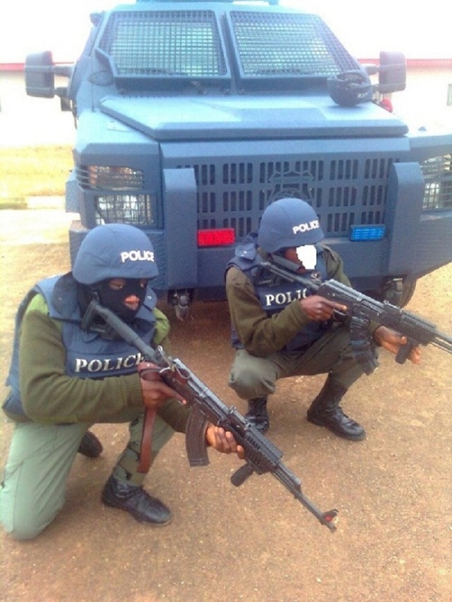 Personnel of the Police Counter Terrorist Unit and a Streit Spartan Mk II APC