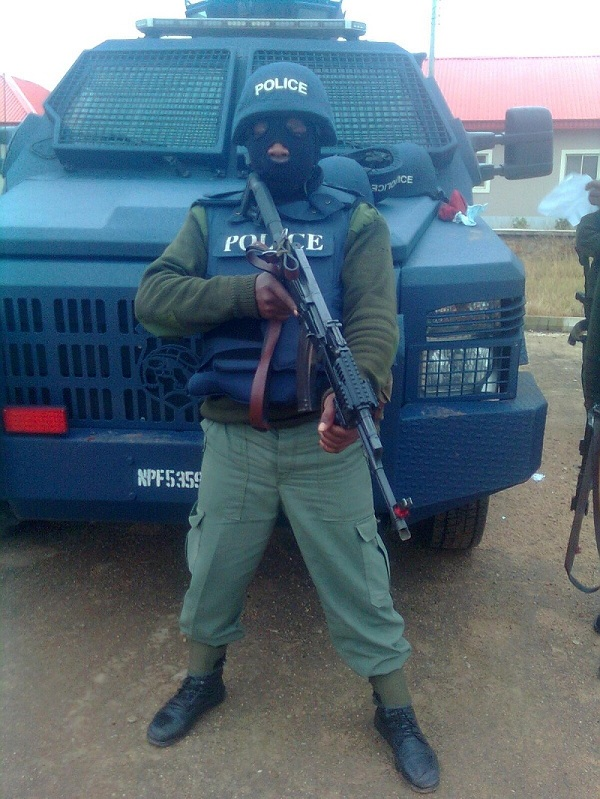 An operative of the Police Counter Terrorist Unit and a Streit Spartan Mk II APC