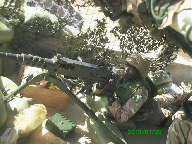 A Nigerian AFISMA soldier mans a Browning 12.7mm heavy machine gun in Mali