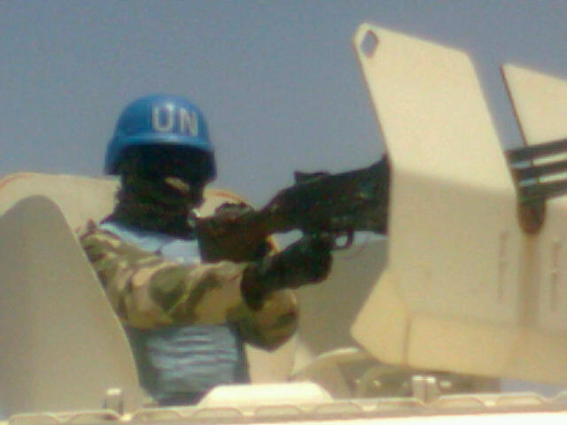 A Nigerian UNAMID peacekeeper mans a GPMG mounted on an Otokar Cobra APC