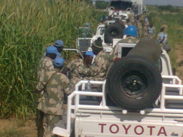 A convoy of Toyota Landcruiser and Hilux 4WD trucks of the Nigerian Army in Darfur, Sudan