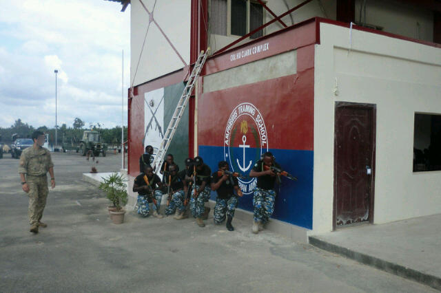 Nigerian Navy Special Boat Service commandos pose beneath their banner