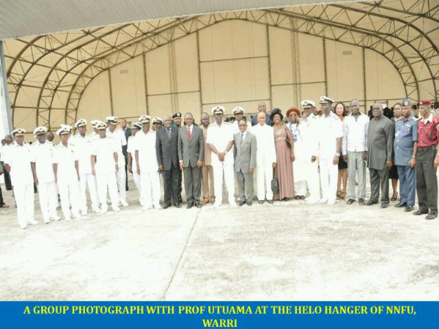 Chief of the Naval Staff,Vice Admiral DJ Ezeoba, flanked by officials dressed in suits,at the hangar