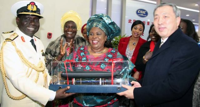 The boss of CSOC presents a model of a submarine to Nigeria's First Lady, Dame Patience Jonathan